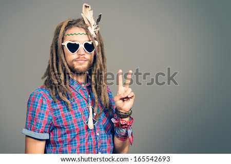 Portrait of a hippie young man in spectacles. - Shutterstock ID 165542693