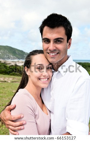 portrait of a hispanic couple in love outdoors