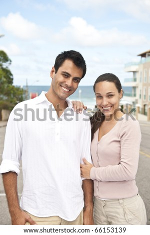 portrait of a hispanic couple in love outdoors - stock photo