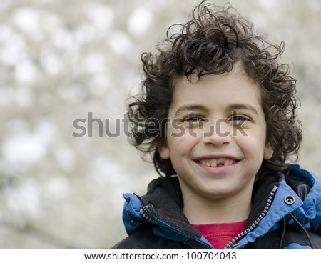 Portrait of a Hispanic young boy outdoors