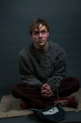 Portrait of a homeless beggar man asking for help