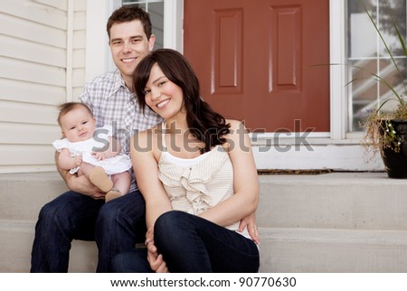 Portrait of a husband and wife with small baby child - stock photoPortrait Of A Husband And Wife