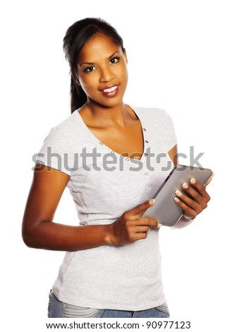 Portrait of a isolated young pretty black woman using a Tablet PC.