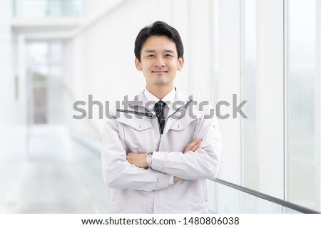 Portrait of a Japanese man in a thirties suit