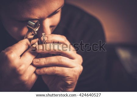 Portrait of a jeweler during the evaluation of jewels. Сток-фото ©