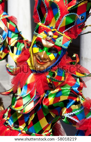 Portrait of a Joker in costume at the Venice Carnival, Italy.