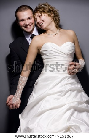 Portrait of a joyful and happy newly-married couple