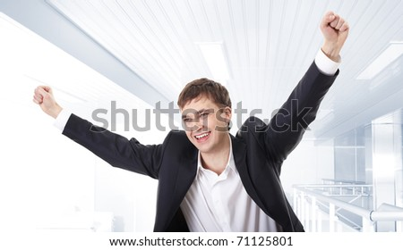 Portrait of a joyful man with raised hands