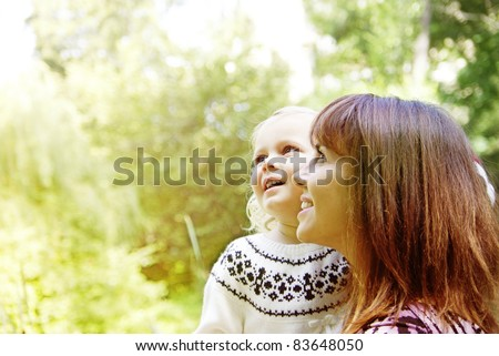 Portrait of a joyful mother and her daughter smiling