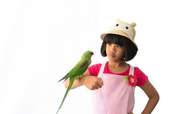 Portrait of a kid girl with her domestic parrot over white background