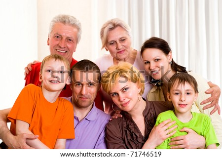 portrait of a large family on a light