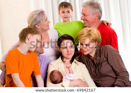 portrait of a large family on a light background