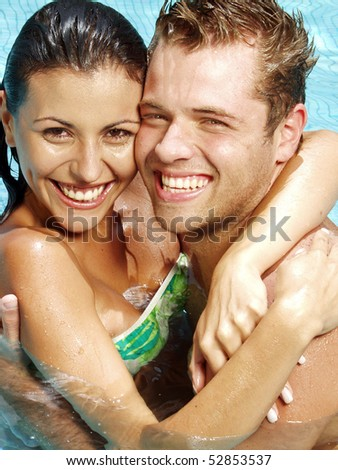 Portrait of a latin couple in a swimming pool,
