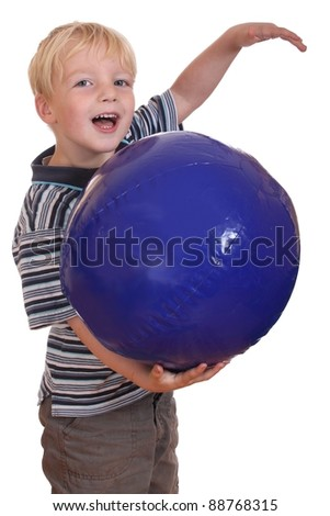 Portrait of a laughing boy holding a big inflatable ball