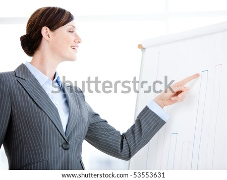 Portrait of a laughing businesswoman talking about a graph during a meeting in the office