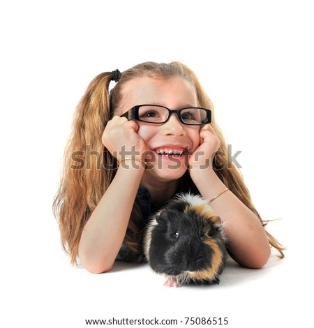 portrait of a laughing little girl and guinea pig in front of white background