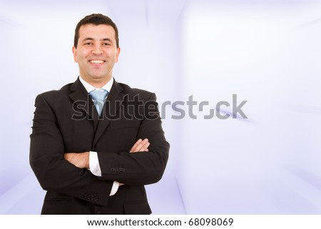 Portrait of a laughing young business man at the office