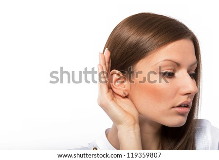 Portrait of a listening young woman, on white background