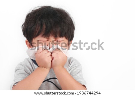 Portrait of a little Asian boy with the flu isolated on white Stock photo ©