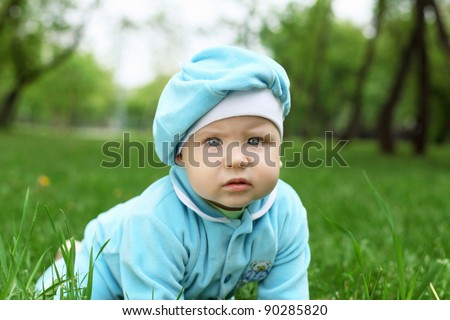 Portrait of a little baby boy in the park - stock photo