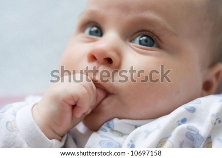 portrait of a little baby boy sucking his thumb