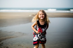 portrait of a little beautiful girl with white hair in the sea
