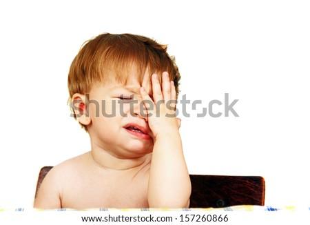 portrait of a little boy close-up photo on light background.