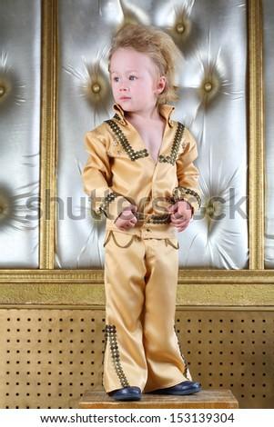 Portrait of a little boy in pop retro suit