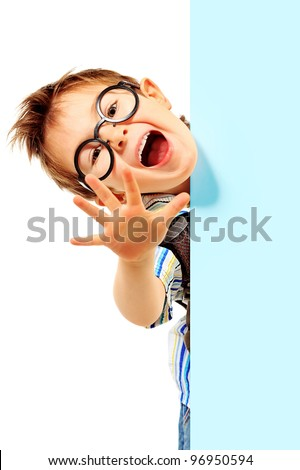 Portrait of a little boy in spectacles with white board. Isolated over white background.
