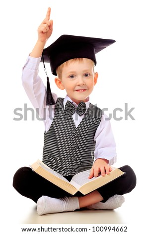 Portrait of a little boy with a book. Isolated over white background.