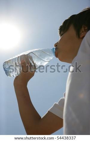 Portrait of a little boy with a bottle of water