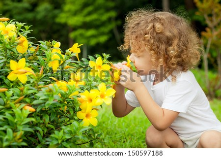portrait of a little boy with flower in hand