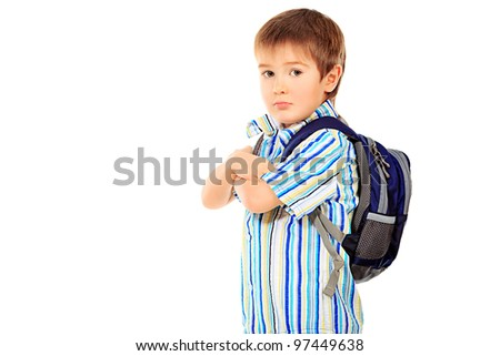Portrait of a little boy with schoolbag. Isolated over white background.