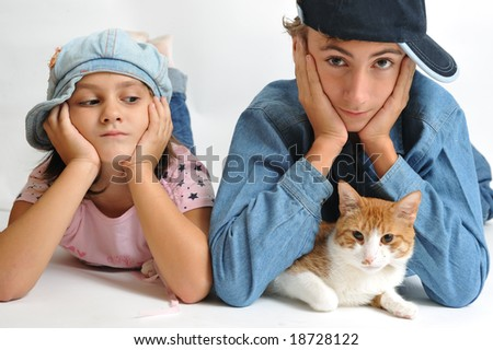 Portrait of a little girl a boy and a cat