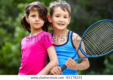 Portrait of a little girl and boy with badminton racket