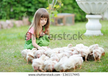 portrait of a little girl and chickens