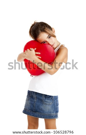 Portrait of a little girl embracing a red balloon, isolated on white background