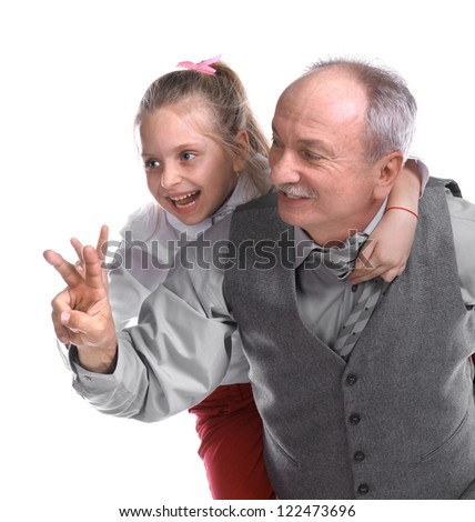 Portrait of a little girl enjoying piggyback ride with her grandfather on a white background