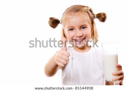 Portrait of a little girl holding a cup of milk, isolated on white