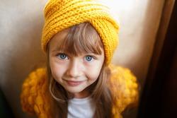 portrait of a little girl in a yellow headdress