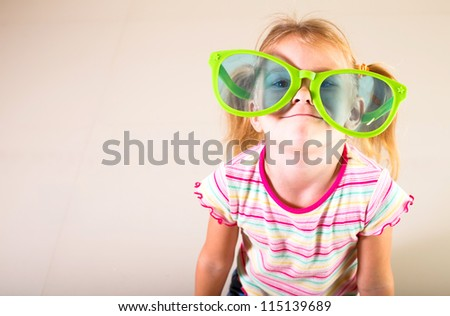 portrait of a little girl in big sunglasses