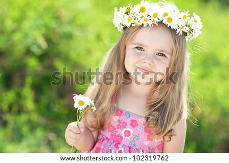 Portrait of a little girl in wreath of flowers #102319762