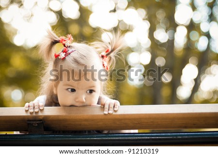 portrait of a little girl spying