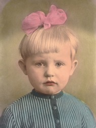 Portrait of a little girl with a bow
