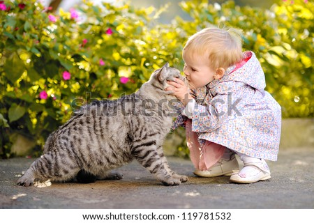 portrait of a little girl with a cat