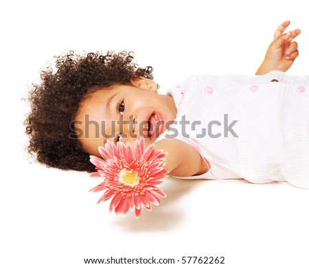 Portrait of a little girl with a pink flower on white background