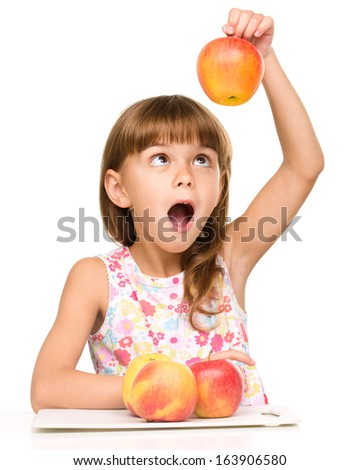 Portrait of a little girl with red apples, isolated over white - stock photo