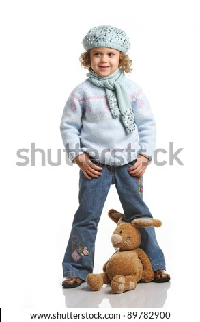 portrait of a little girl with soft toys on a white background