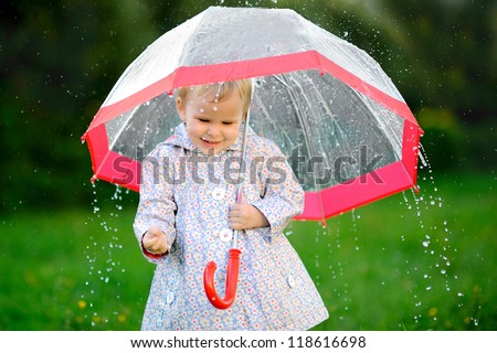 portrait of a little girl with umbrella