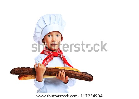Portrait of a little kitchen boy holding french bread. Isolated over white background.